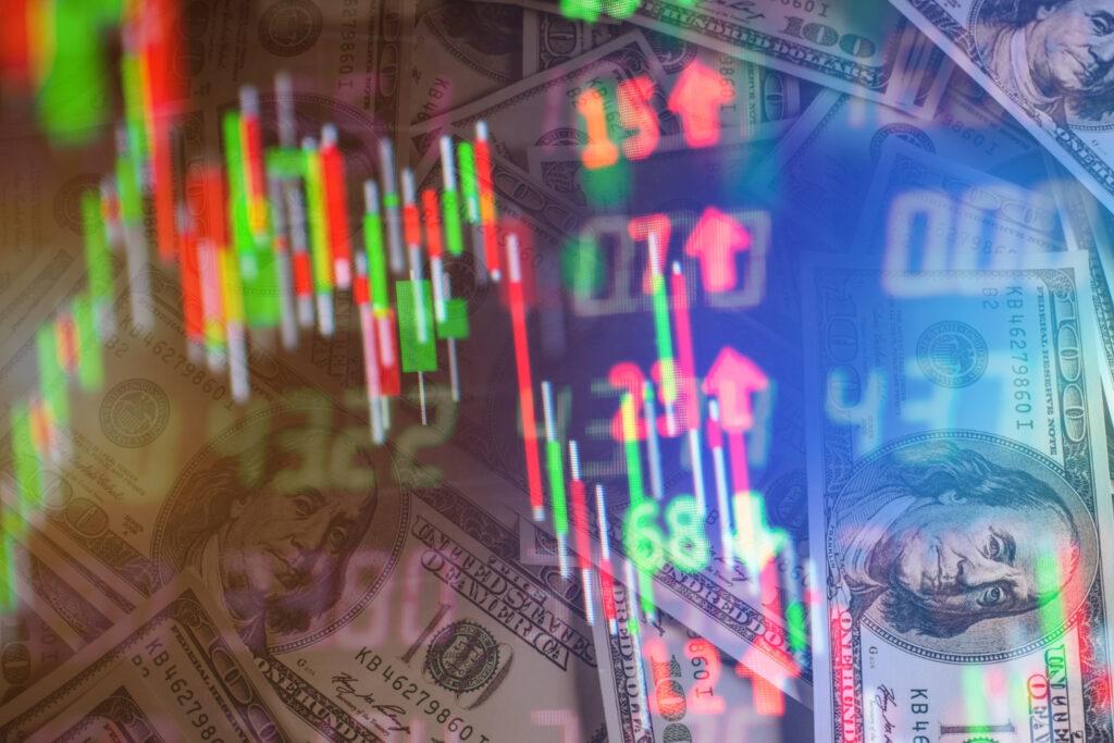 A imagem tem várias setas, números e candles de gráficos com notas de dólares e outros números ao fundo para mostrar a movimentação do IPO