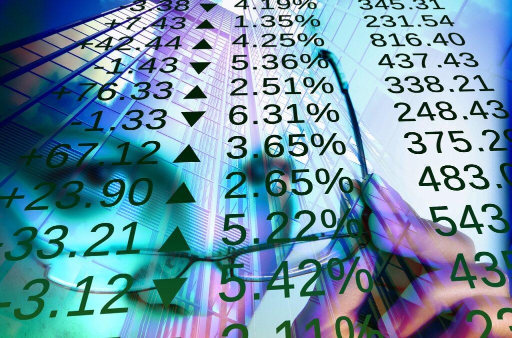A imagem tem vários números escritos em porcentagem com setas para cima e para baixo mostrando a volatilidade da bolsa de valores, que gera o circuit breaker em caso de queda expressiva